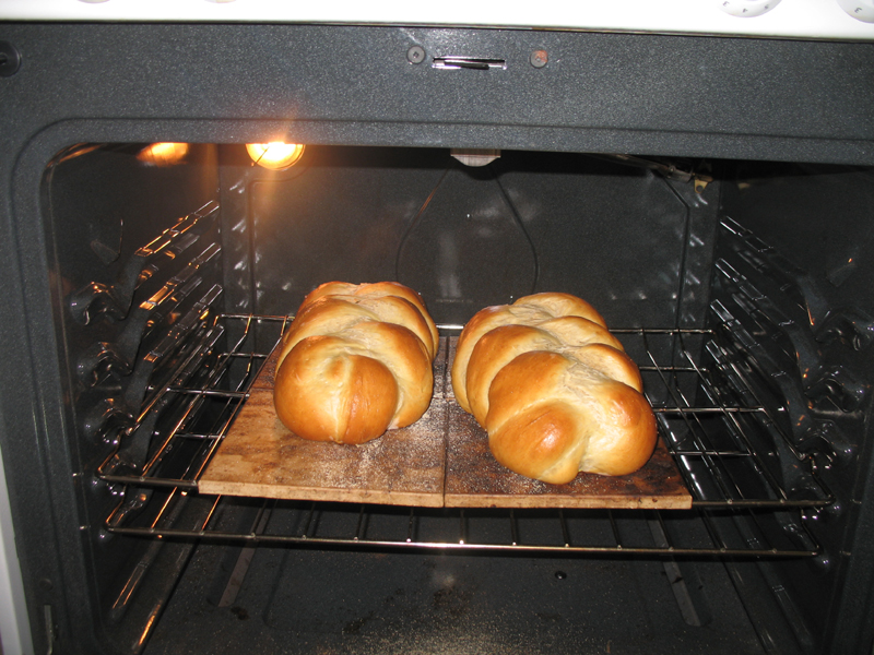 two large challah baking in the oven